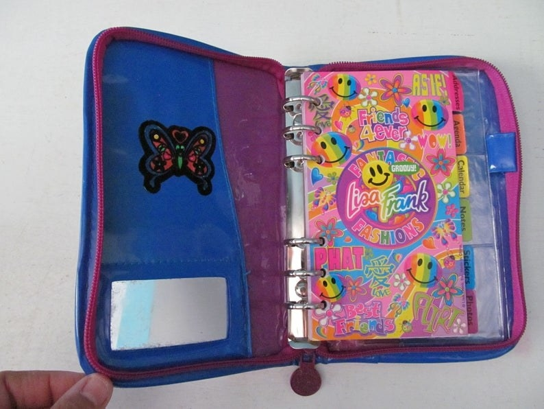 A pink, blue, and purple Lisa Frank day planner
