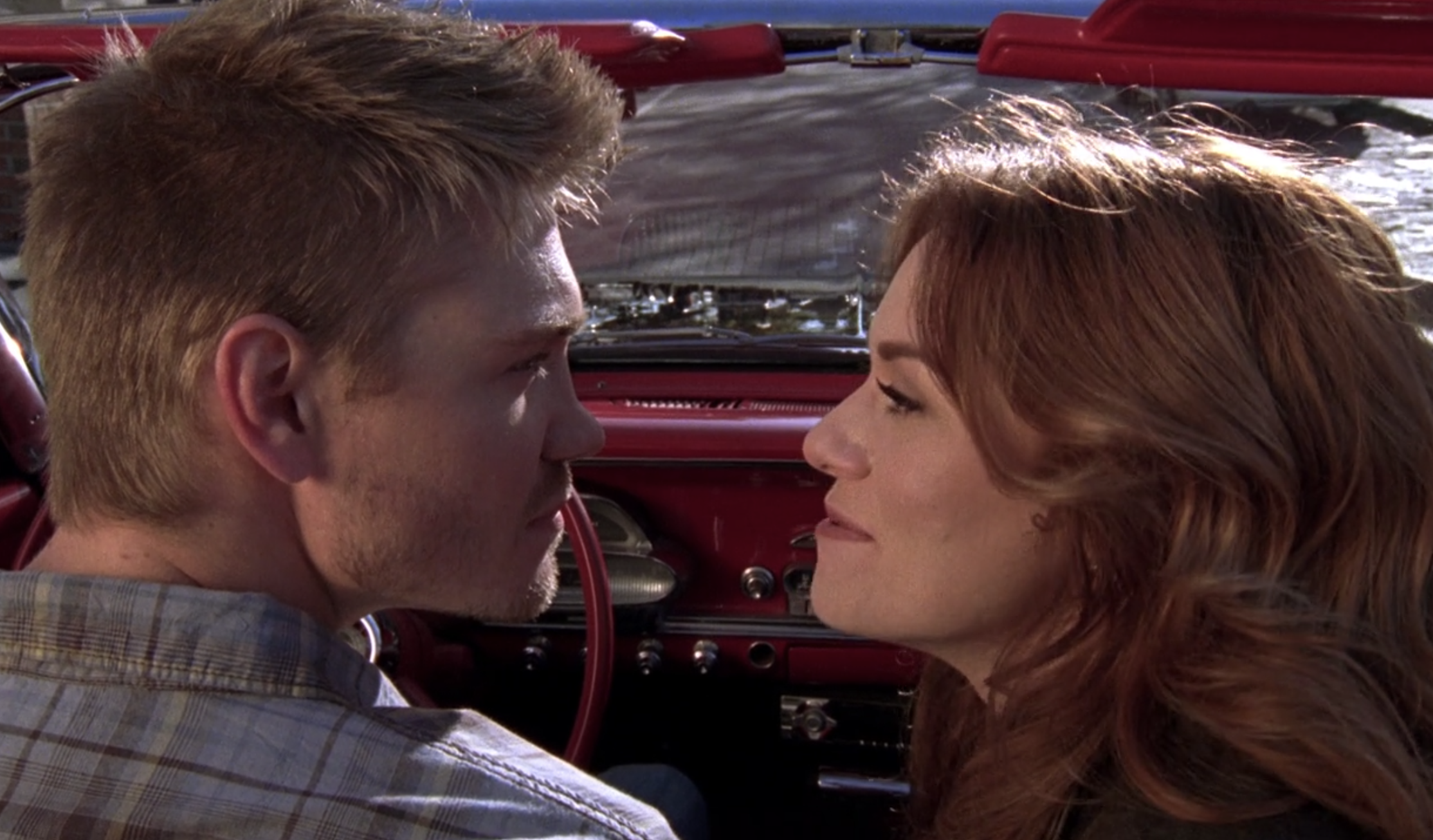 Lucas and Peyton in Peyton's car driving out of Tree Hill