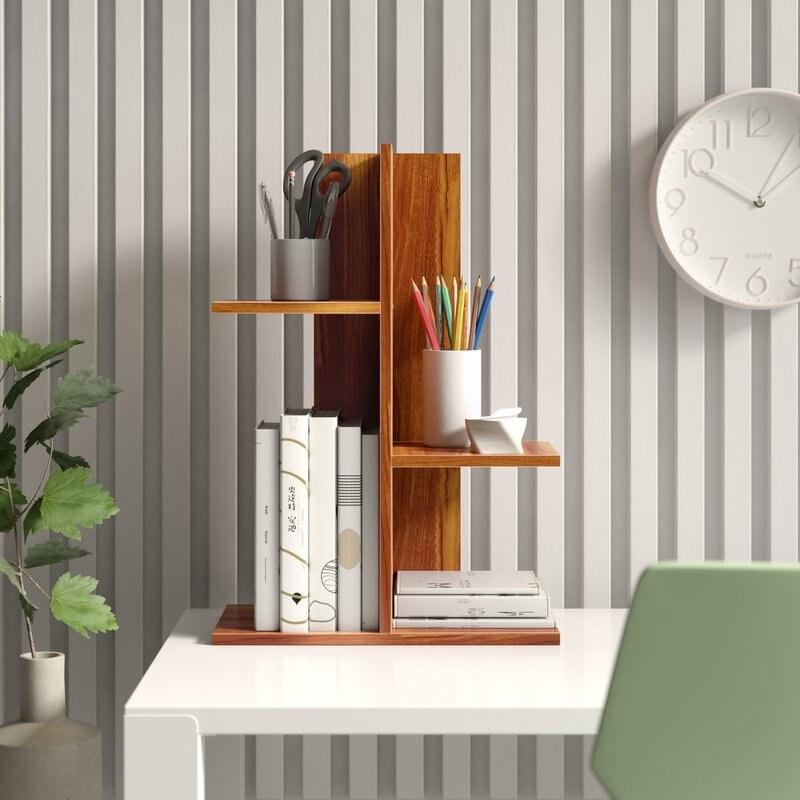 A wooden vertical desk organizer unit with four shelves