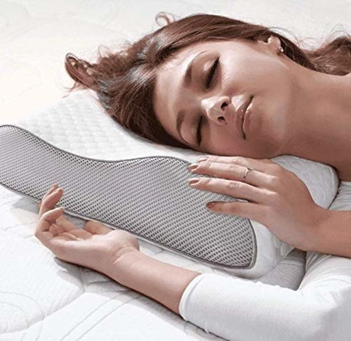 A person sleeping on the pillow.