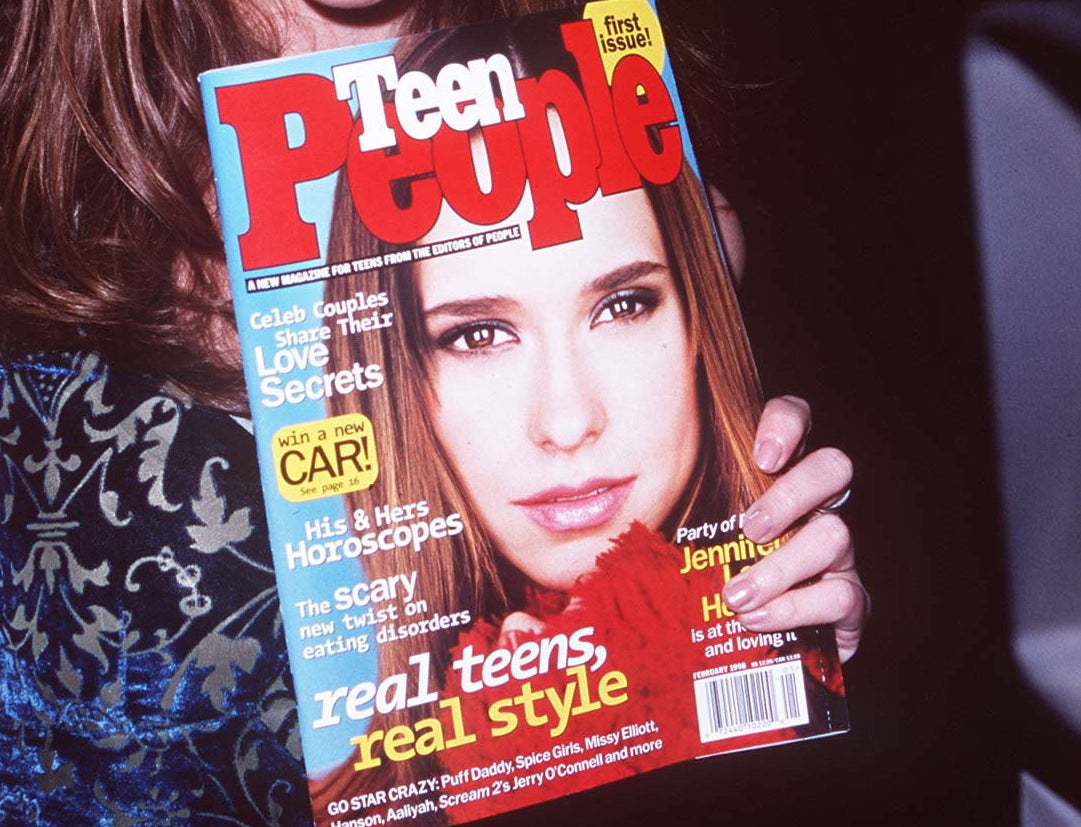 A close-up of Jennifer Love Hewitt holding a Teen People with herself on the cover