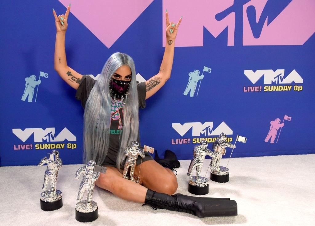 Gaga posing in a face mask with five VMAs