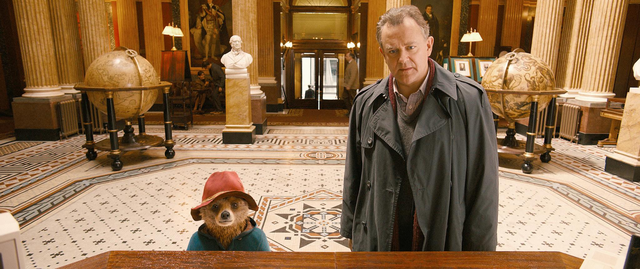 Paddington standing next to Mr Brown
