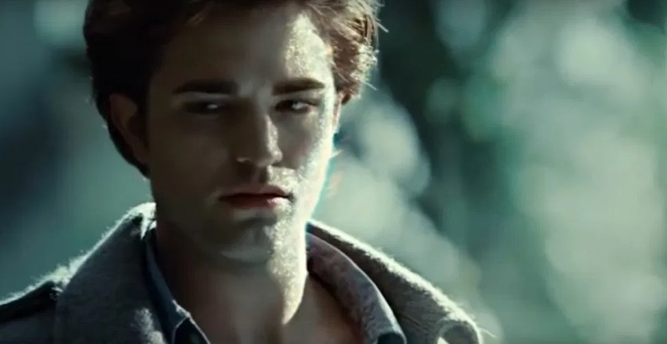 Still from Twilight: Edward looking sad, his skin sparkling in the sun