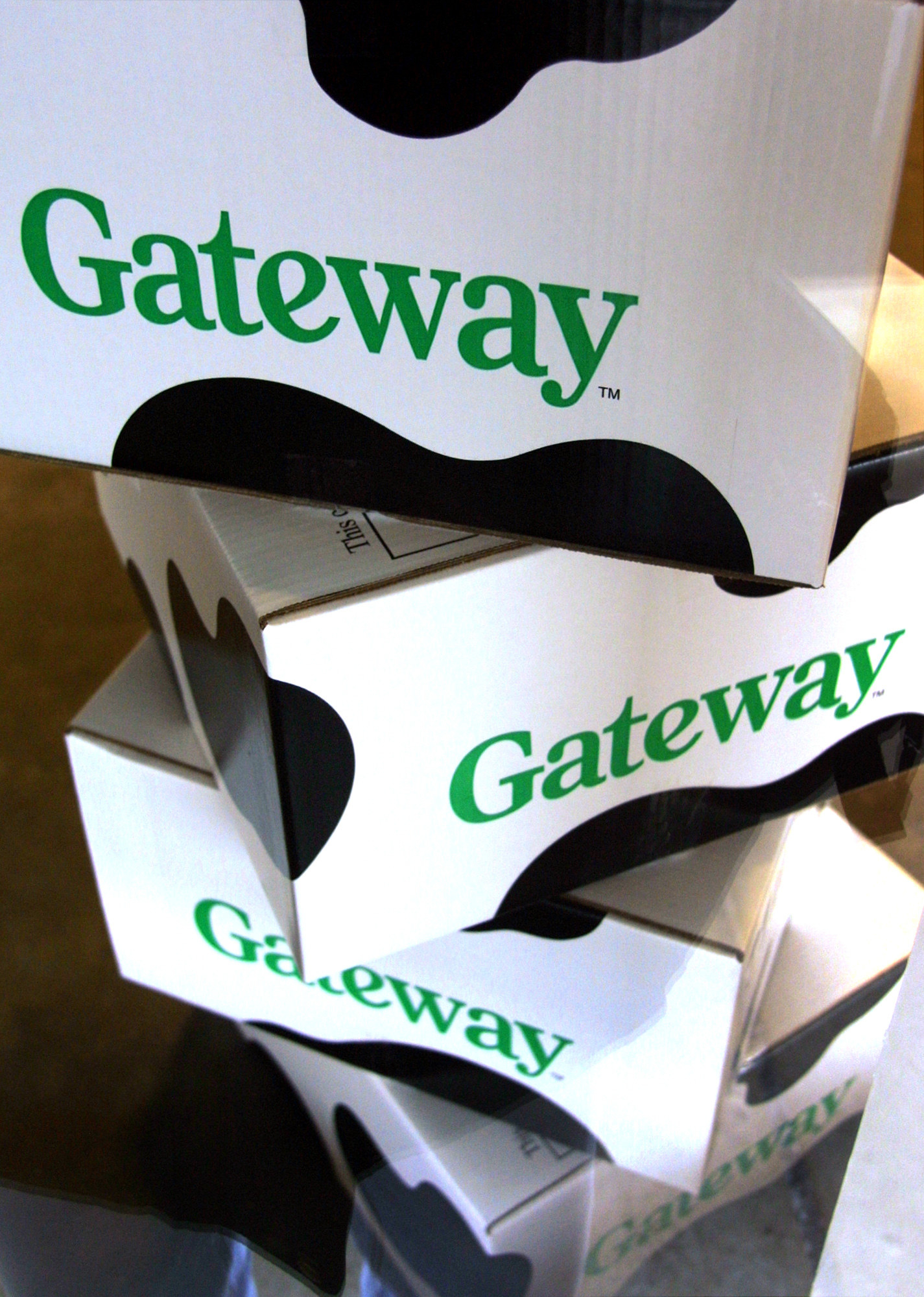 A stack four Gateway computer boxes.