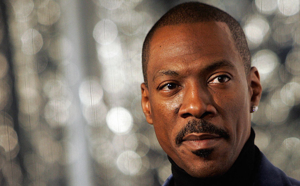 A close of Eddie Murphy in a black turtleneck at an event