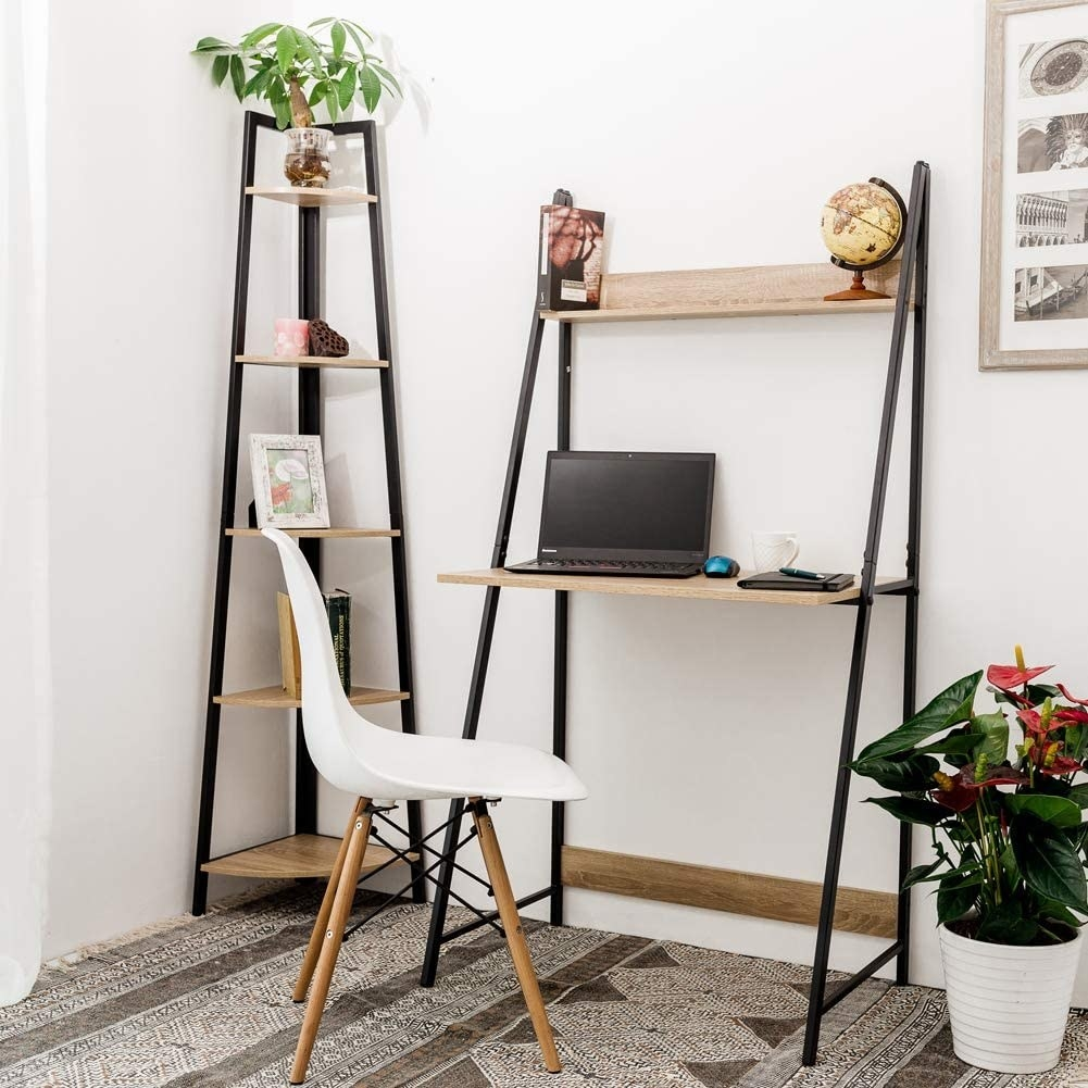 A wooden desk with a metal frame and a small shelf above