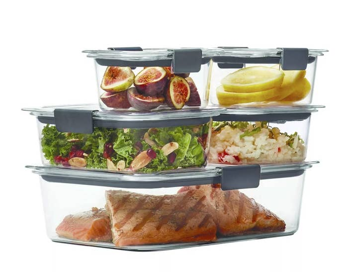 The set of five storage containers with food in them
