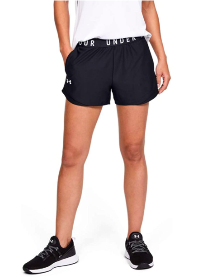 Model wears black Under Armour shorts with a white tee and matching black sneakers