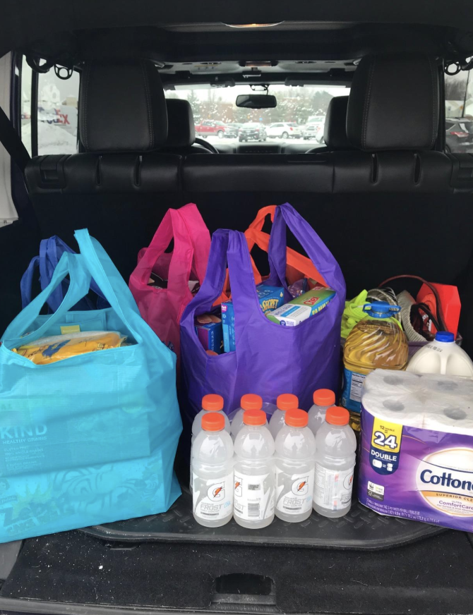 Reviewer image of colorful bags full of groceries in a trunk