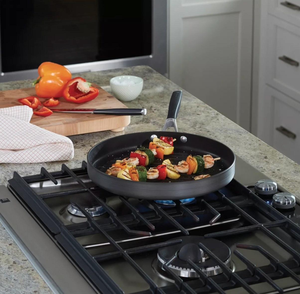 The grill pan being used to cook kabobs