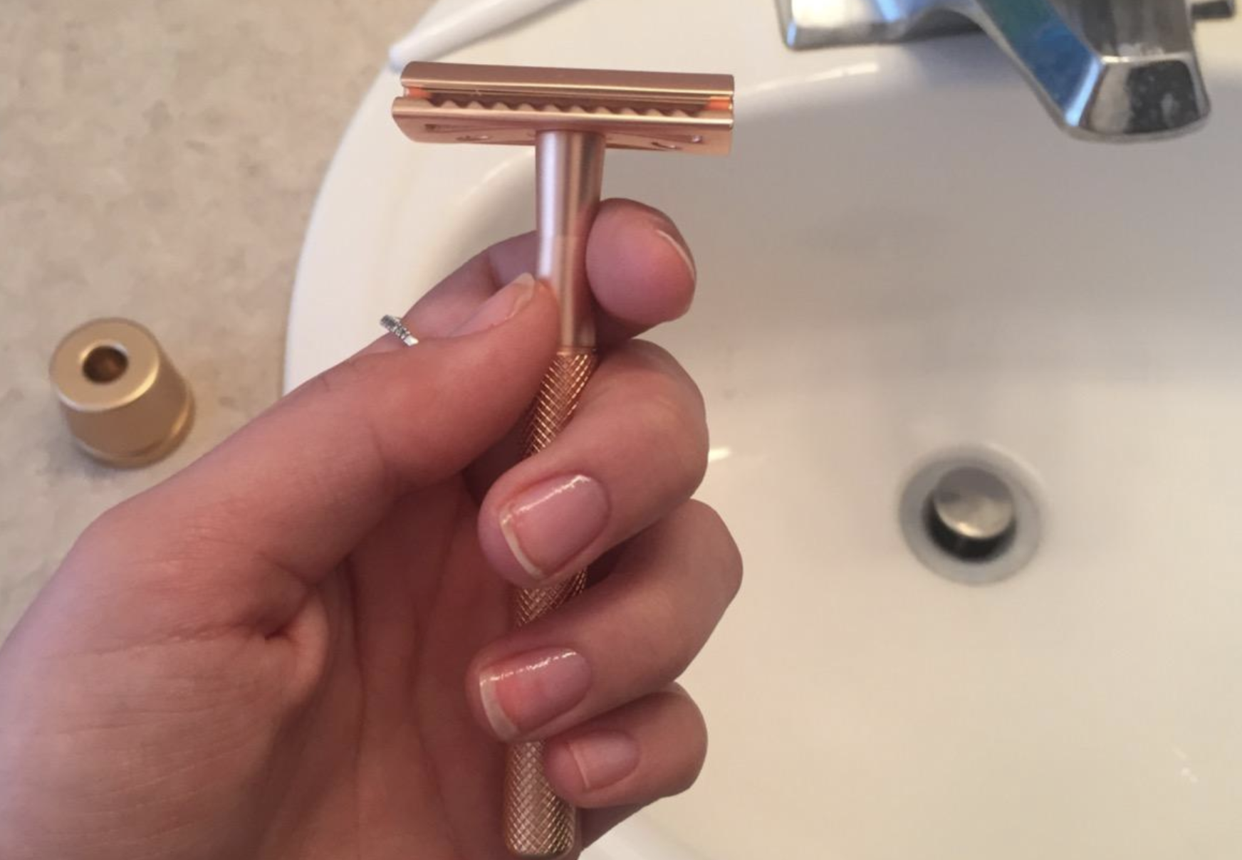 A reviewer holding up the razor