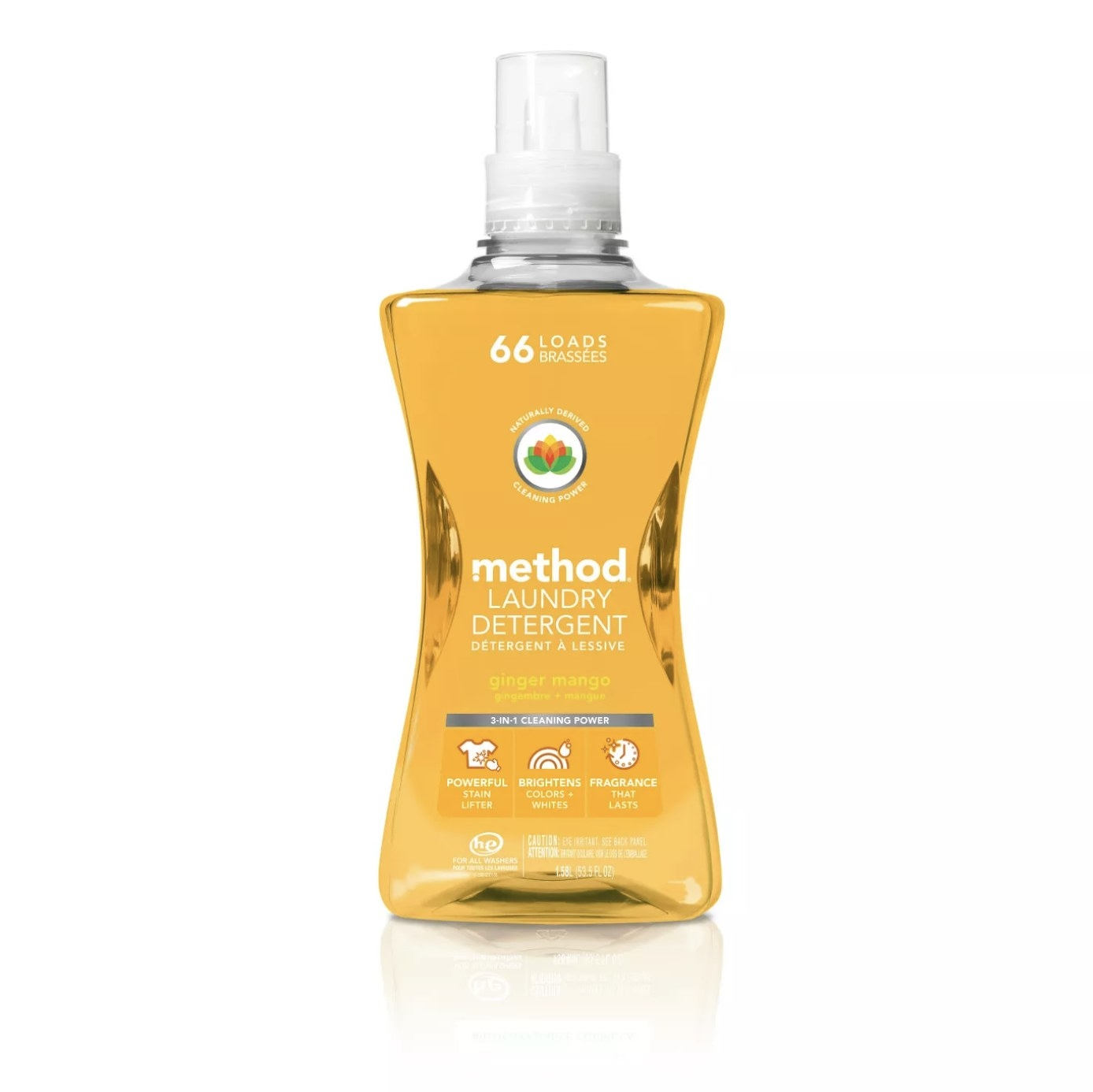 Clear bottle of Method Laundry Detergent with a mango-colored liquid inside