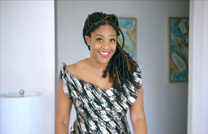 Tiffany Haddish smiling in a photo shoot