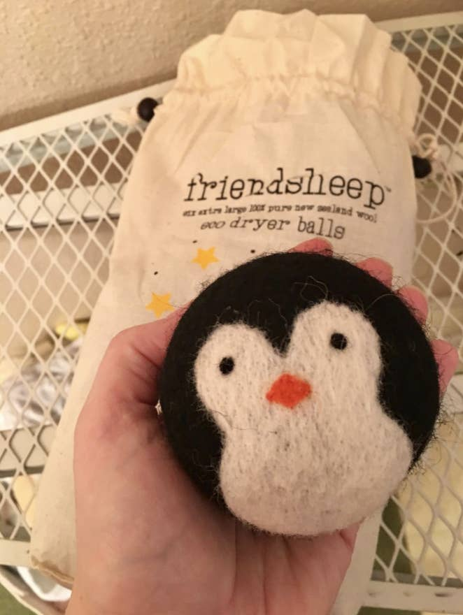 A reviewer image of a penguin shaped dryer ball