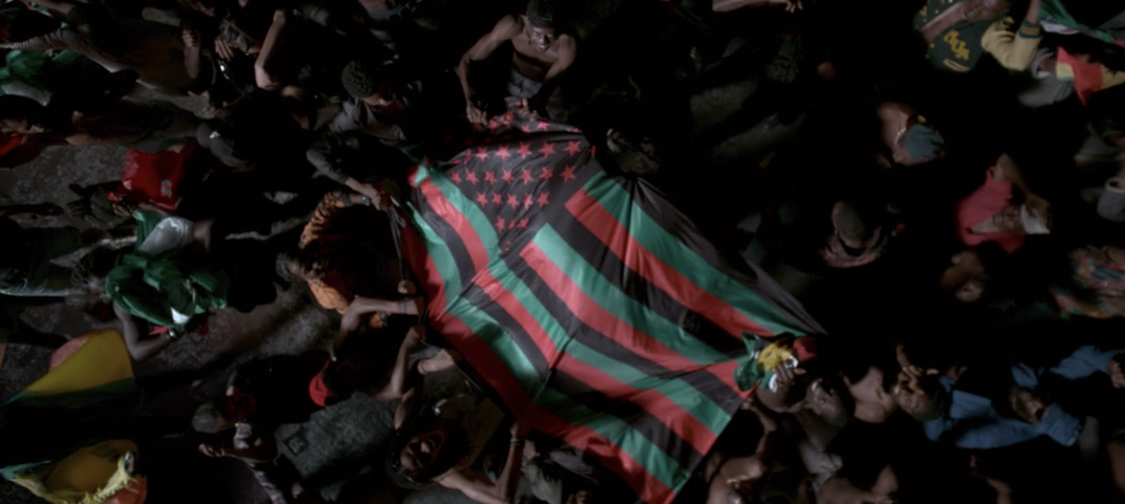 African-American flag held by a bunch of people
