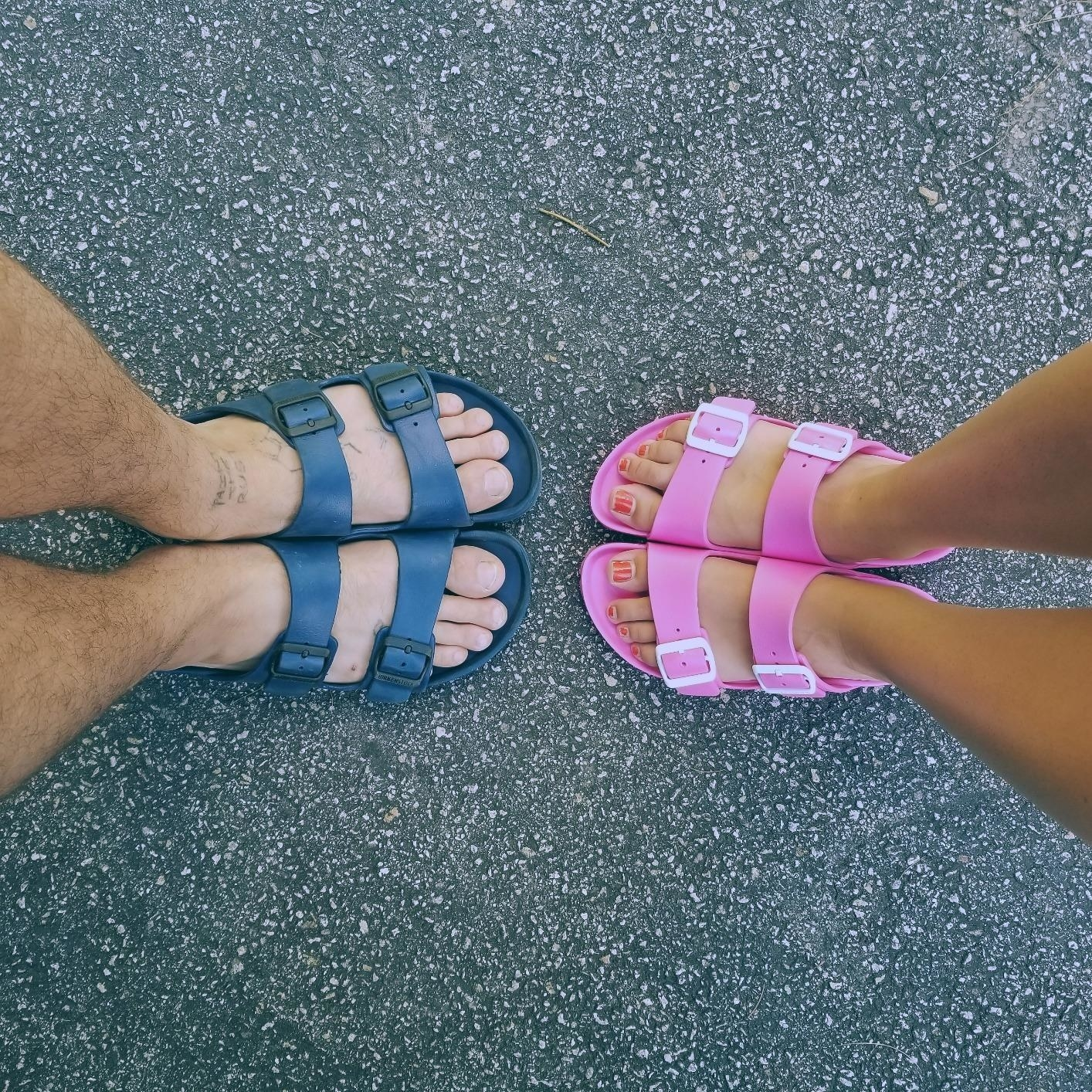 two reviewers's pairs of feet: one in blue, the other in pink Birkenstocks