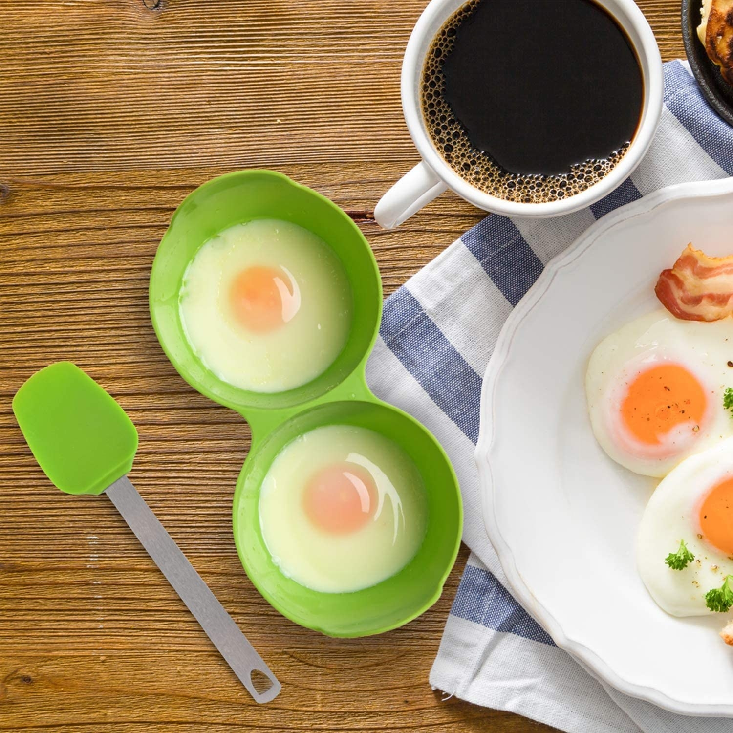 Two poached eggs in the silicone egg poaching cup.