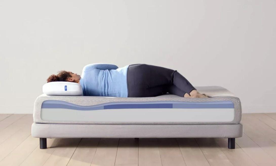 Model laying on the mattress