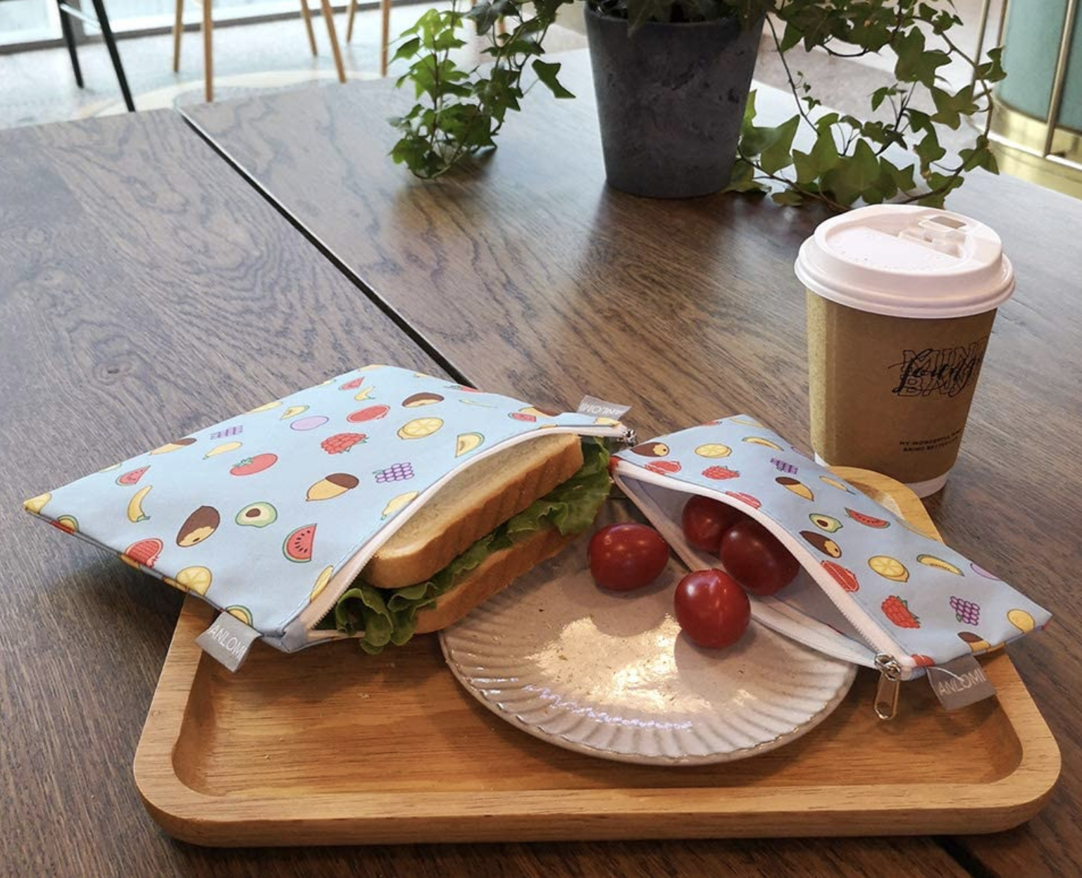 A sandwich size and snack size bag with a sandwich and tomatoes in them