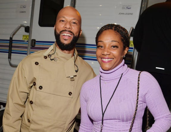Common and Tiffany Haddish smiling together on set
