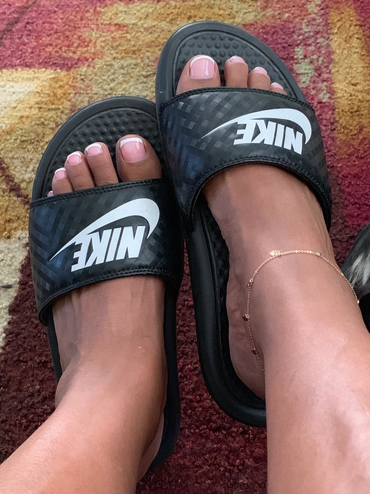 Reviewer wearing the sandals in black