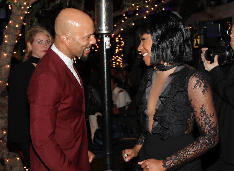 Common and Tiffany Haddish smiling at each other