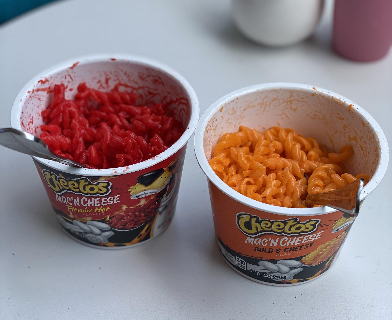 Prepared Flamin' Hot and Bold & Cheesy Cheetos mac n cheese cups
