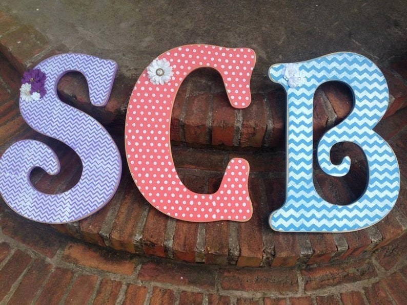 """Wooden letters """"S,"""" """"C,"""" and """"B"""" painted in fun colors and patterns"""