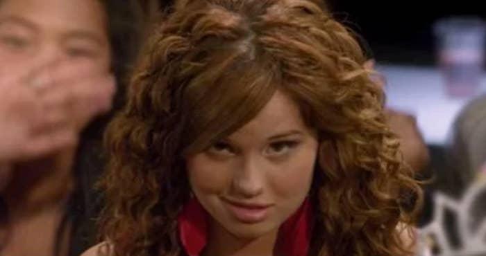 Debby's character Tara making a weird, cringe smirk
