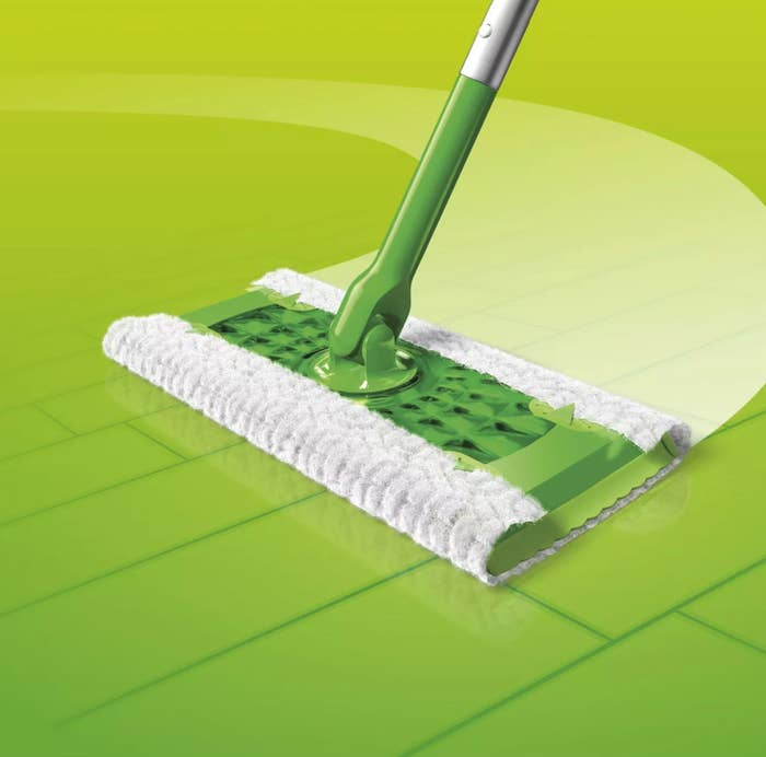 Green Swiffer Sweeper with soft sweeping cloth wipes grime from a hardwood floor