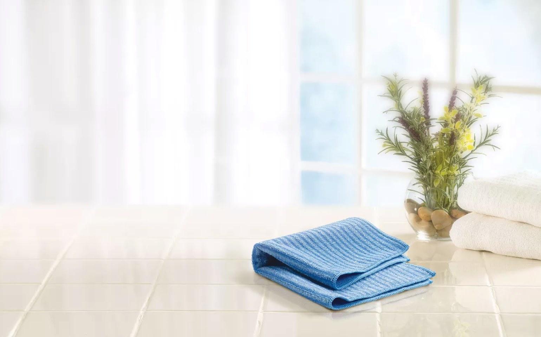 Blue microfiber cloth folded up on a table