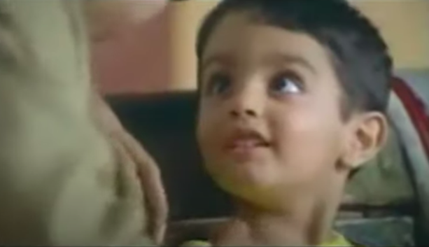 Image of a small child from an Indian commercial for Dhara Oil.