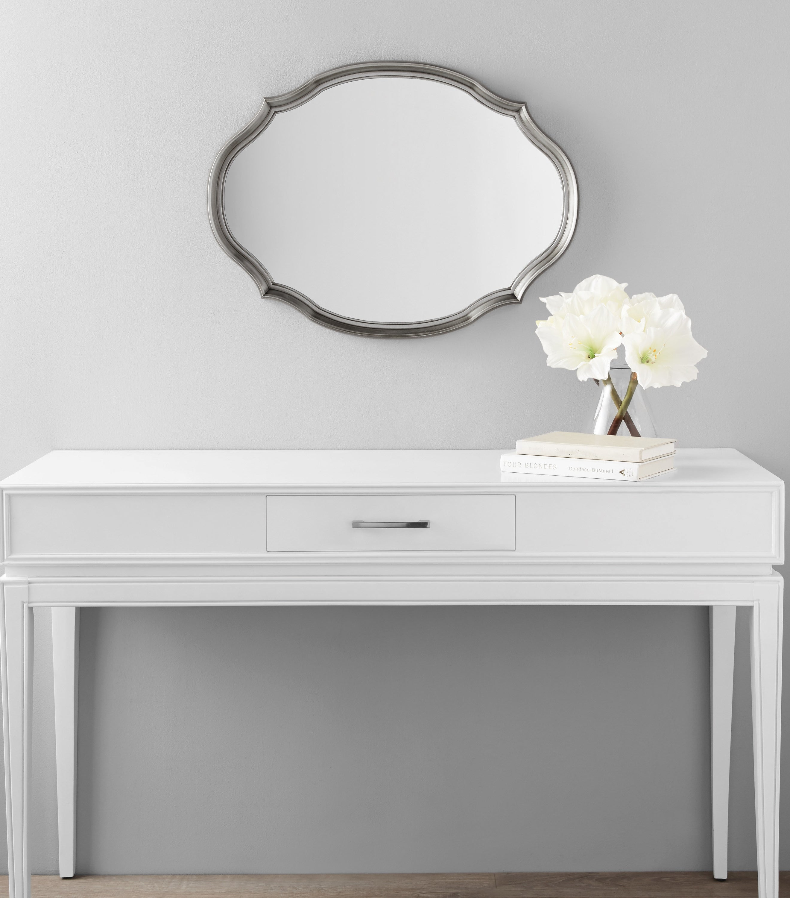 a white desk with a small center drawer