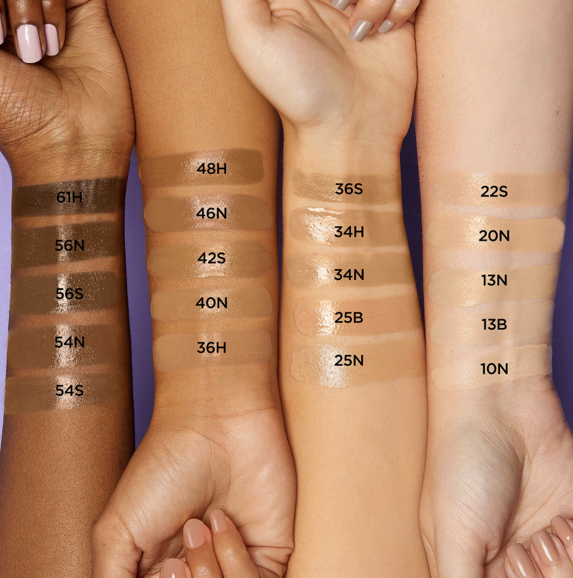 four arms of different skin tones with all the shades of the moisturizer swatched on them