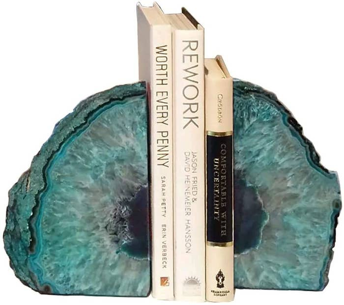 teal agate bookends holding three books