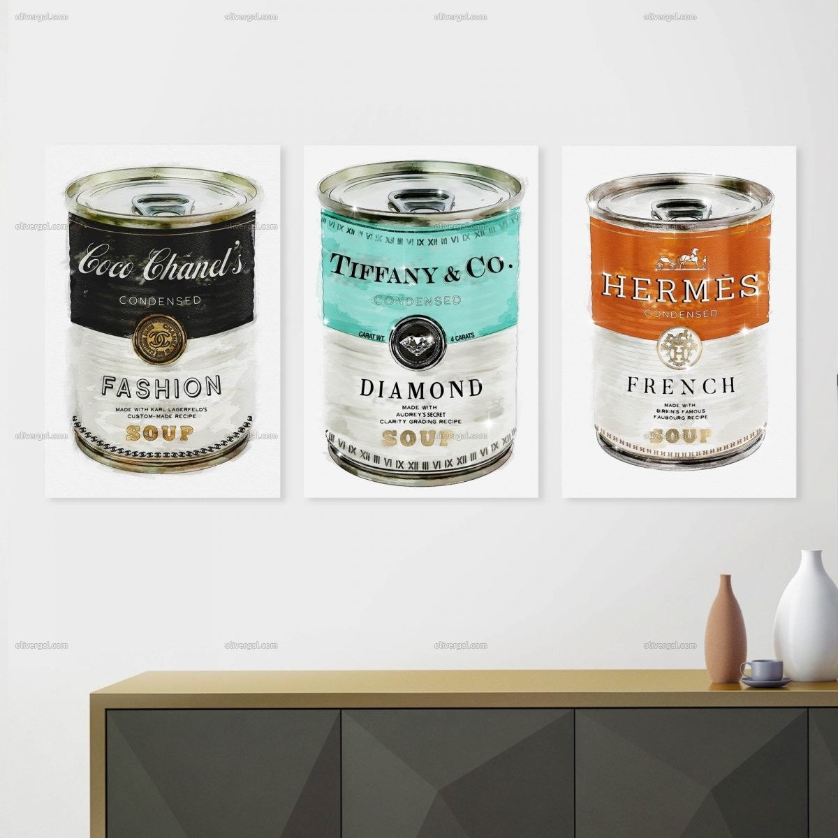 three pieces of wall art in style of Andy Warhol pop art soup cans in Chanel, Tiffany's, and Hermes