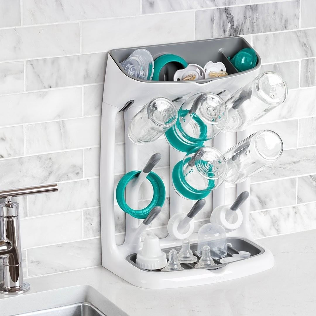 The bottle rack laden with caps lids and bottles perched on a countertop