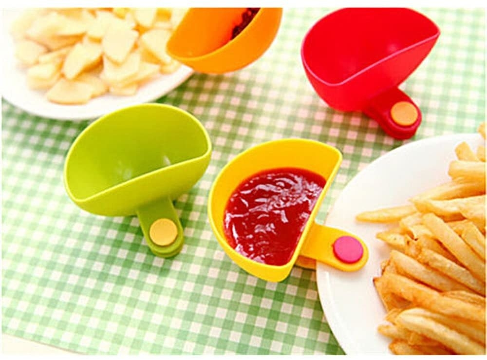 The dip clip filled with ketchup and attached to a plate of french fries