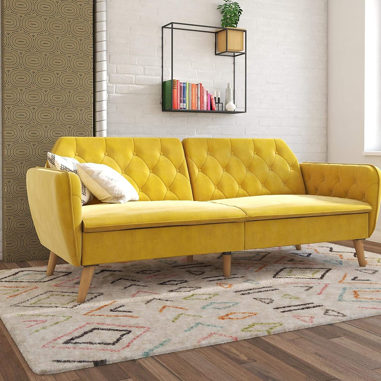 yellow mid-century style futon with wooden leg that looks like a regular sofa