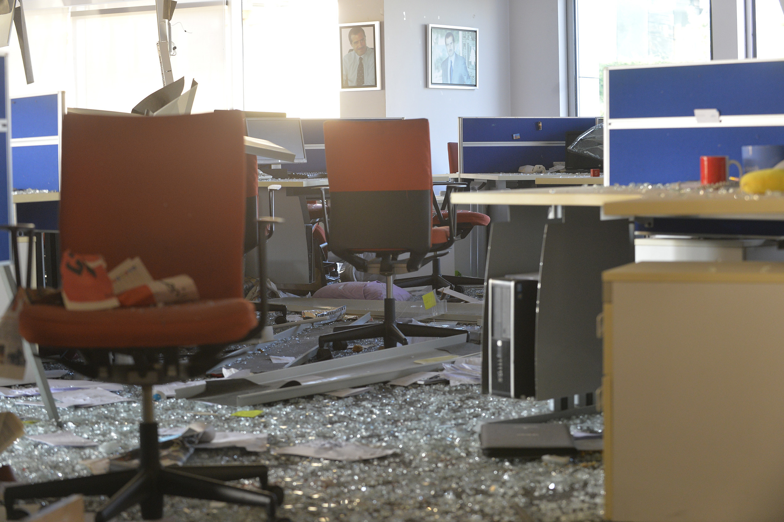 An office with broken glass and debris everywhere