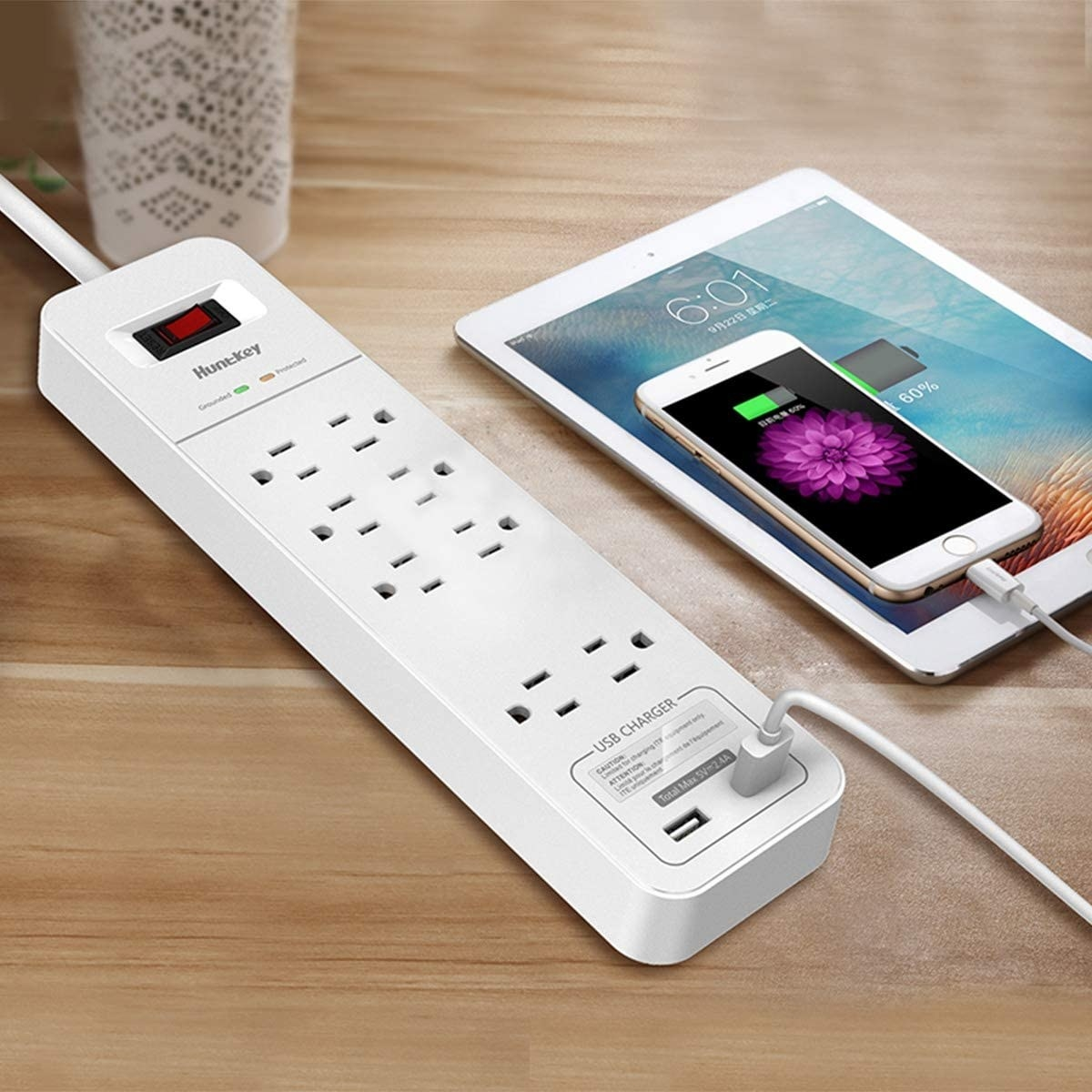 A long power bar with eight outlets along with two USB ports