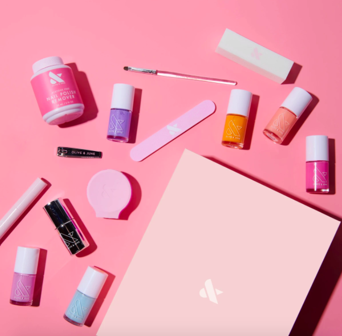 The Everything Box manicure kit displayed on a pink table