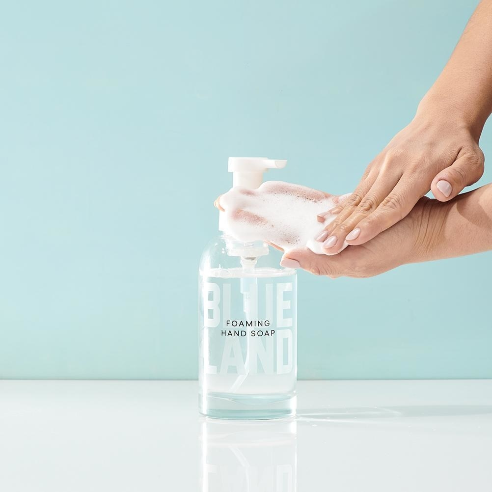hand getting foaming soap from soap pump