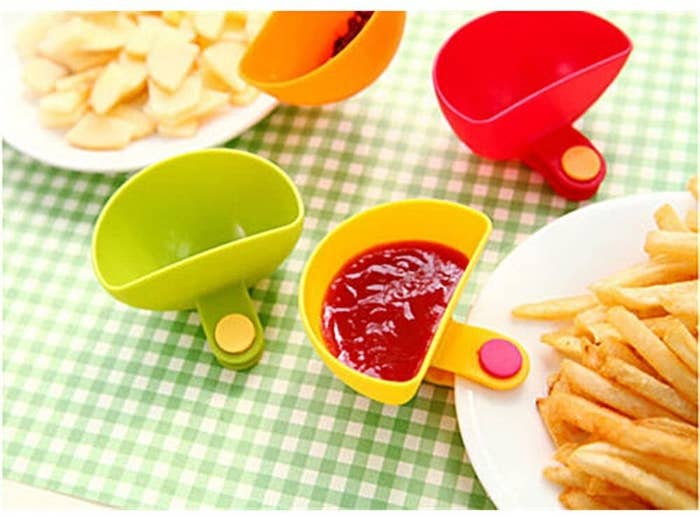 plate of fries with dip clip attached to the plate with ketchup in it