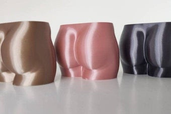 three planters in shape of butts