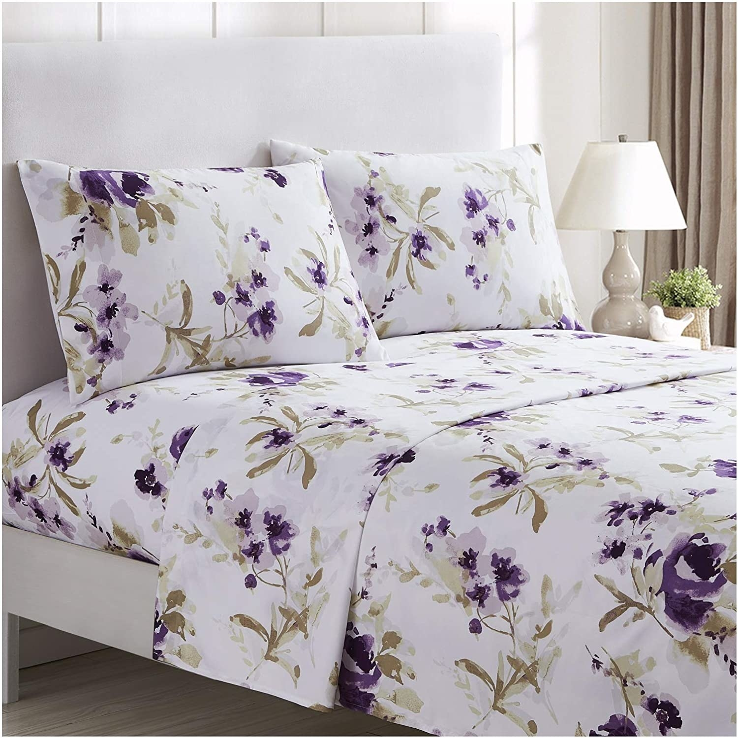 A bed made up with the Mellanni Bed Sheet Set in Madison Purple.