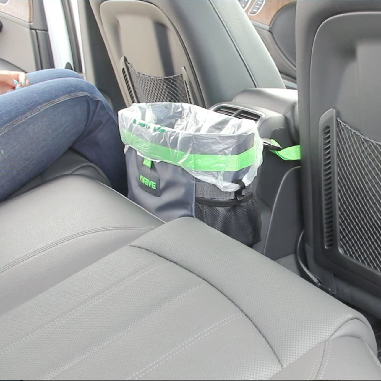 The large garbage bin attached to the car console in the backseat