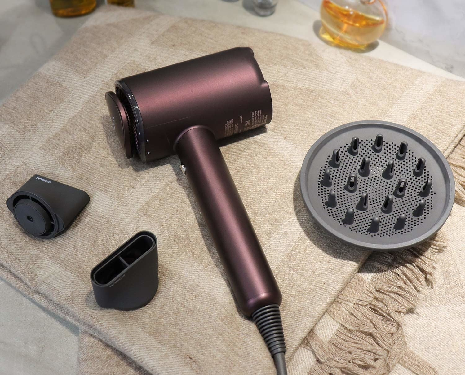 the purple hair dryer with magnetic attachments