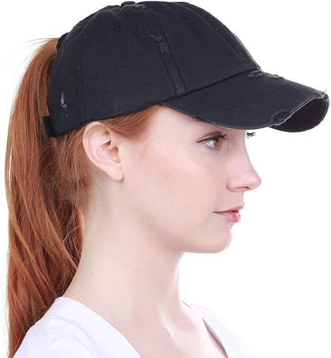 A person wearing the hat with a high ponytail